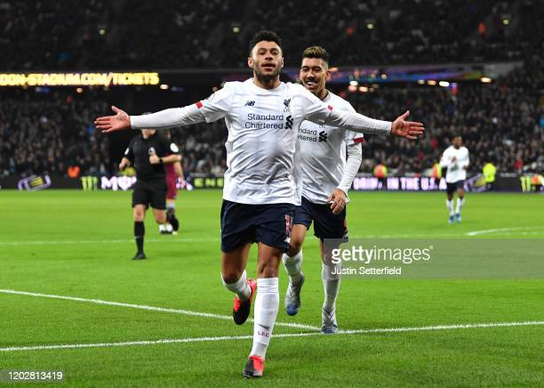 Alex OxladeChamberlain of Liverpool celebrates after scoring his team's second goal during the Premier League match between West Ham United and...