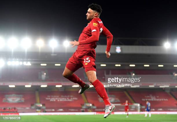 Alex Oxlade-Chamberlain of Liverpool celebrates after scoring his team's fifth goal during the Premier League match between Liverpool FC and Chelsea...