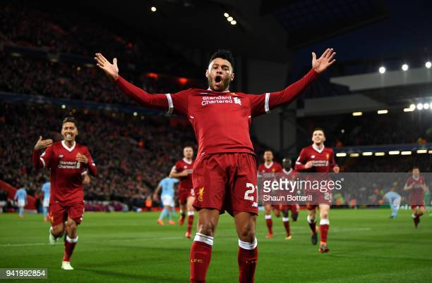 Alex OxladeChamberlain of Liverpool celebrates after scoring his sides second goal during the UEFA Champions League Quarter Final Leg One match...