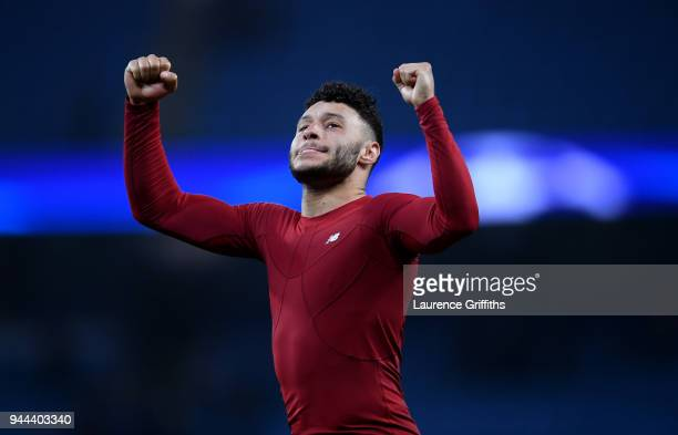 Alex OxladeChamberlain of Liverpool celebrates after the final whistle during the UEFA Champions League Quarter Final Second Leg match between...