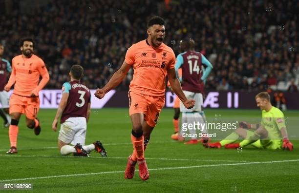 Alex OxladeChamberlain of Liverpool celebrates scoring his sides third goal during the Premier League match between West Ham United and Liverpool at...