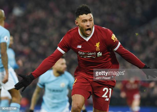 Alex OxladeChamberlain of Liverpool Celebrates the opener during the Premier League match between Liverpool and Manchester City at Anfield on January...