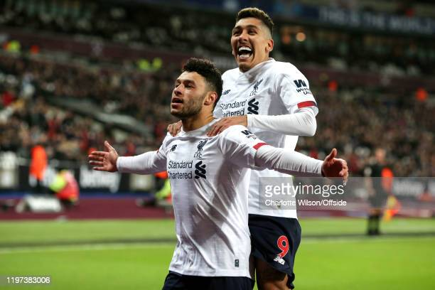 Alex OxladeChamberlain of Liverpool celebrates their 2nd goal with Roberto Firmino during the Premier League match between West Ham United and...