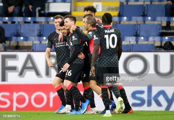 Alex Oxlade-Chamberlain of Liverpool celebrates with Andrew Robertson and team mates after scoring their side's third goal during the Premier League...