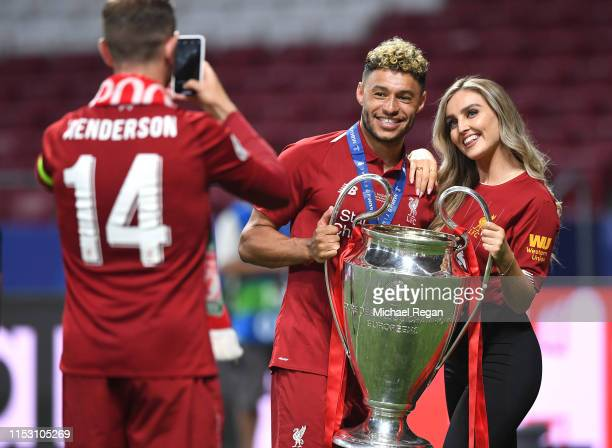 Alex Oxlade-Chamberlain of Liverpool celebrates with his girlfriend Perrie Edwards after his side won during the UEFA Champions League Final between...
