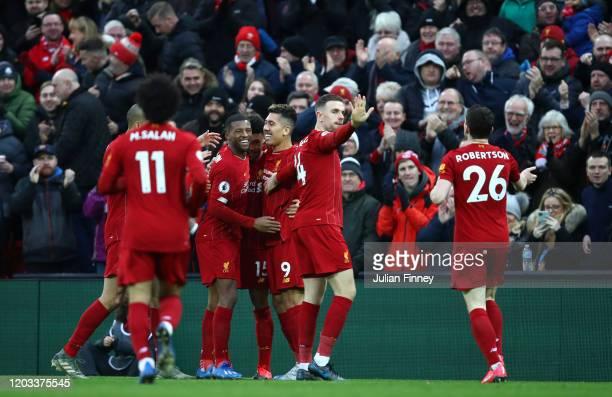 Alex OxladeChamberlain of Liverpool celebrates with his team mates after scoring his team's first goal during the Premier League match between...