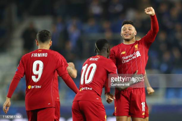 Alex OxladeChamberlain of Liverpool celebrates with teammate Sadio Mane after scoring his team's first goal during the UEFA Champions League group E...
