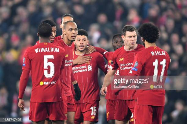 Alex Oxlade-Chamberlain of Liverpool celebrates with teammates after scoring his team's second goal during the UEFA Champions League group E match...
