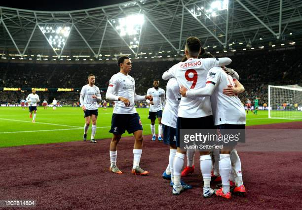 Alex Oxlade-Chamberlain of Liverpool celebrates with teammates after scoring his team's second goal during the Premier League match between West Ham...