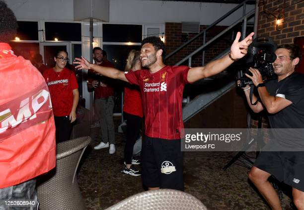 Alex Oxlade-Chamberlain of Liverpool celebrating winning the Premier League on June 25, 2020 in Liverpool, England.