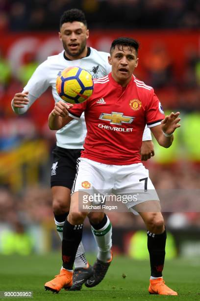 Alex OxladeChamberlain of Liverpool chases down Alexis Sanchez of Manchester United during the Premier League match between Manchester United and...