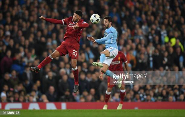 Alex OxladeChamberlain of Liverpool competes for a header with Bernardo Silva of Manchester City during the UEFA Champions League Quarter Final...