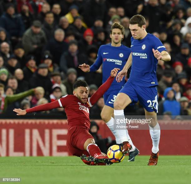 Alex OxladeChamberlain of Liverpool competes with Andreas Christensen of Chelsea during the Premier League match between Liverpool and Chelsea at...