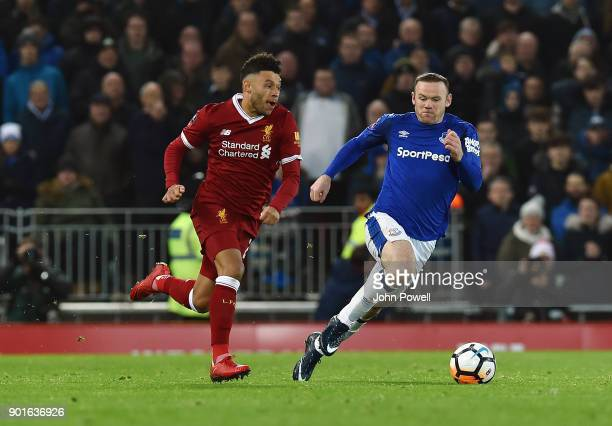 Alex OxladeChamberlain of Liverpool competes with Wayne Rooney of Everton during The Emirates FA Cup Third Round match between Liverpool and Everton...