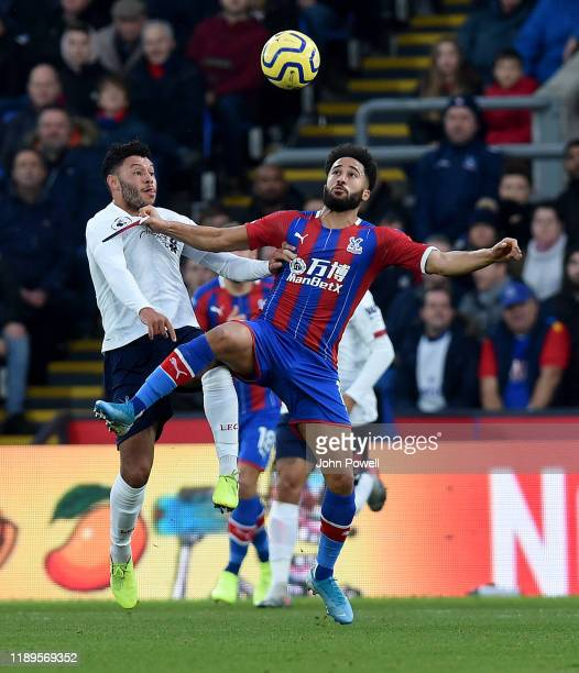 Alex OxladeChamberlain of Liverpool competing with Andros Townsend of Crystal Palace during the Premier League match between Crystal Palace and...