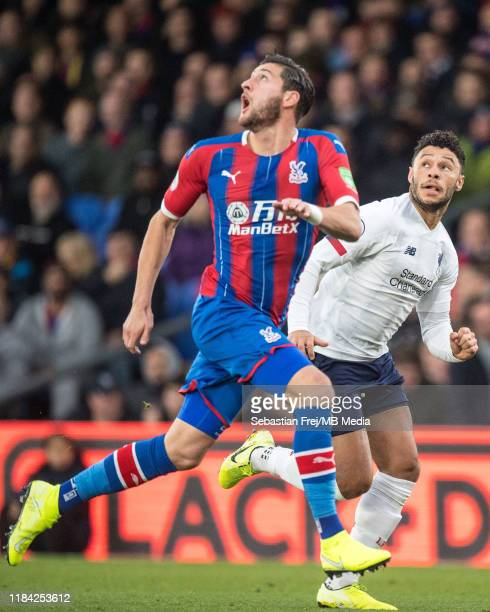 Alex OxladeChamberlain of Liverpool FC and Joel Ward of Crystal Palace during the Premier League match between Crystal Palace and Liverpool FC at...