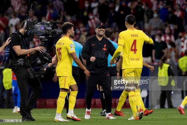 Alex Oxlade-Chamberlain of Liverpool FC, head coach Juergen Klopp of Liverpool FC and Virgil van Dijk of Liverpool FC celebrate after winning during...