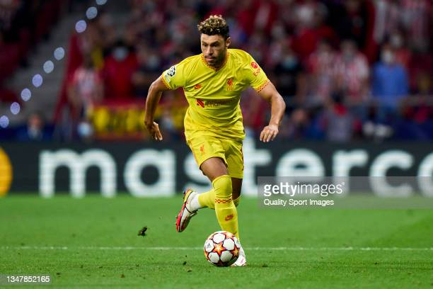 Alex Oxlade-Chamberlain of Liverpool FC runs with the ball during the UEFA Champions League group B match between Atletico Madrid and Liverpool FC at...
