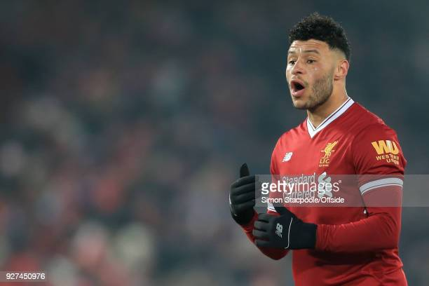 Alex OxladeChamberlain of Liverpool gestures during the Premier League match between Liverpool and Newcastle United at Anfield on March 3 2018 in...