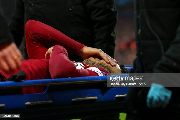 Alex OxladeChamberlain of Liverpool goes off on a stretcher during the UEFA Champions League Semi Final First Leg match between Liverpool and AS Roma...