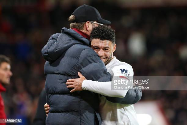 Alex OxladeChamberlain of Liverpool hugs manager Jurgen Klopp as he is substituted off during the Premier League match between AFC Bournemouth and...
