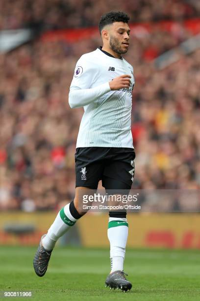 Alex OxladeChamberlain of Liverpool in action during the Premier League match between Manchester United and Liverpool at Old Trafford on March 10...