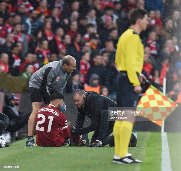 Alex OxladeChamberlain of Liverpool injured during the UEFA Champions League Semi Final First Leg match between Liverpool and AS Roma at Anfield on...