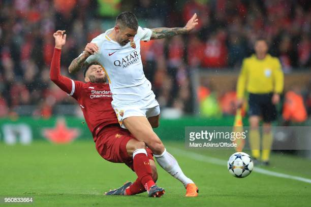 Alex OxladeChamberlain of Liverpool injures himself challenging Aleksandar Kolarov of ASRoma during the UEFA Champions League Semi Final First Leg...