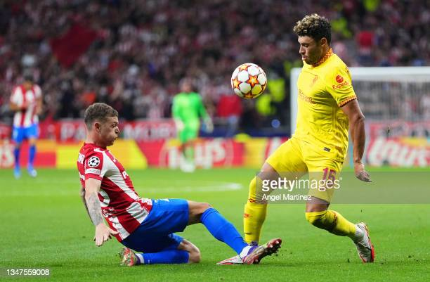 Alex Oxlade-Chamberlain of Liverpool is challenged by Kieran Trippier of Atletico Madrid during the UEFA Champions League group B match between...