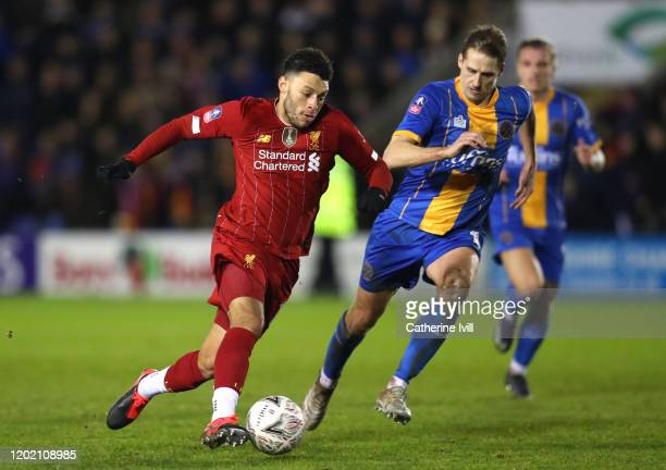 Alex OxladeChamberlain of Liverpool is closed down by David Edwards of Shrewsbury Town during the FA Cup Fourth Round match between Shrewsbury Town...