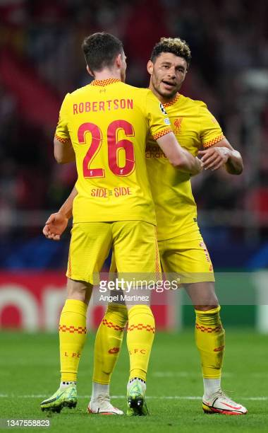 Alex Oxlade-Chamberlain of Liverpool is congratulated by Andrew Robertson of Liverpool after the UEFA Champions League group B match between Atletico...