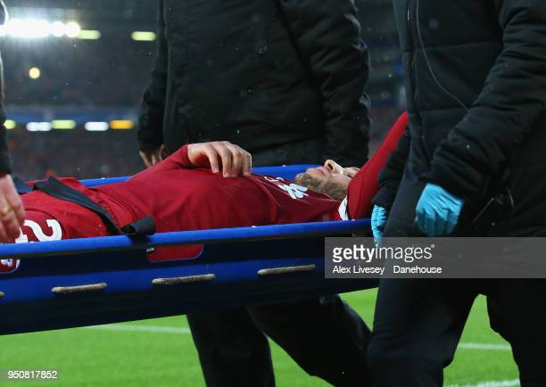 Alex OxladeChamberlain of Liverpool is stretchered off during the UEFA Champions League Semi Final First Leg match between Liverpool and AS Roma at...