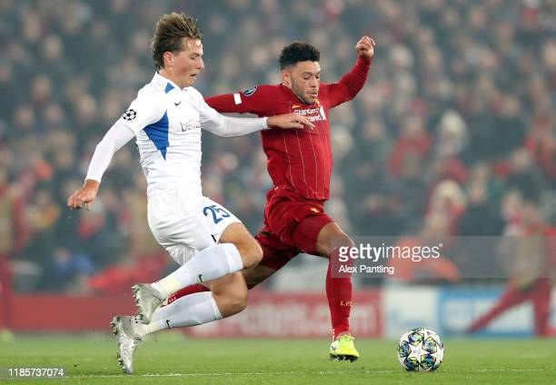 Alex OxladeChamberlain of Liverpool is tackled by Sander Berge of KRC Genk during the UEFA Champions League group E match between Liverpool FC and...