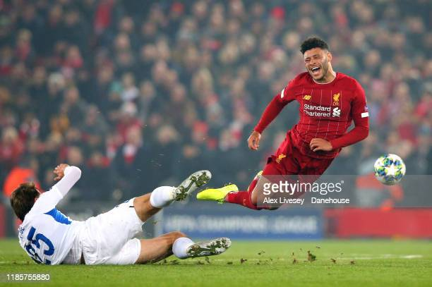 Alex Oxlade-Chamberlain of Liverpool is tackled by Sander Berge of KRC Genk during the UEFA Champions League group E match between Liverpool FC and...