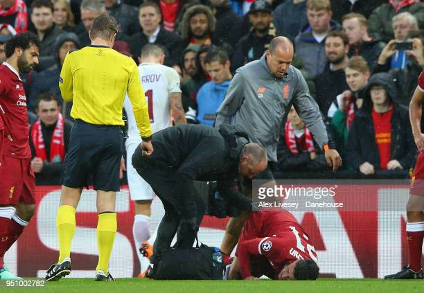 Alex OxladeChamberlain of Liverpool lies injiured during the UEFA Champions League Semi Final First Leg match between Liverpool and AS Roma at...