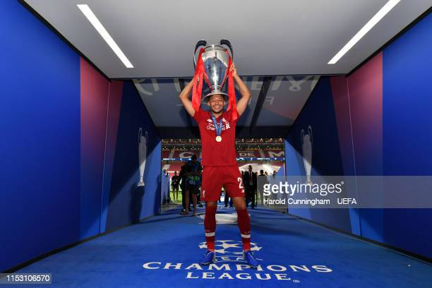 Alex OxladeChamberlain of Liverpool poses with the Champions League Trophy after winning the UEFA Champions League Final between Tottenham Hotspur...