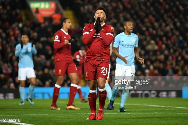 Alex OxladeChamberlain of Liverpool reacts after a missed chance during the Premier League match between Liverpool and Manchester City at Anfield on...