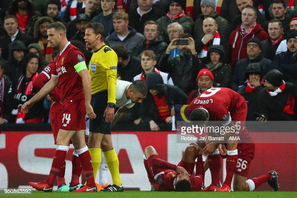 Alex OxladeChamberlain of Liverpool reacts after picking up an injury which results in him being take off on a stretcher during the UEFA Champions...