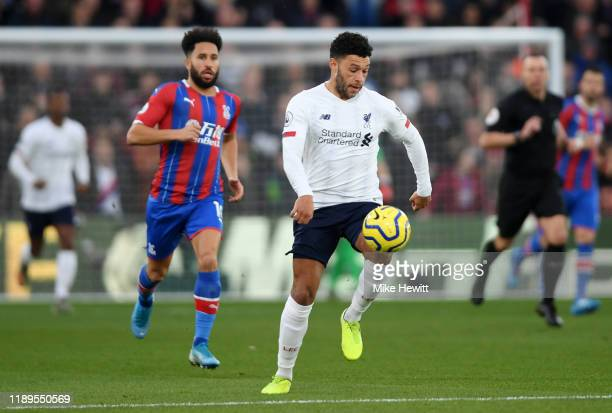 Alex OxladeChamberlain of Liverpool runs with the ball during the Premier League match between Crystal Palace and Liverpool FC at Selhurst Park on...