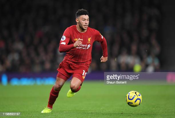 Alex Oxlade-Chamberlain of Liverpool runs with the ball during the Premier League match between Tottenham Hotspur and Liverpool FC at Tottenham...