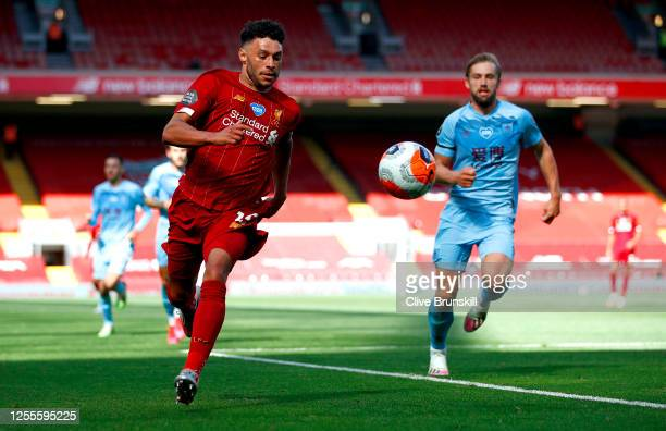 Alex OxladeChamberlain of Liverpool runs with the ball during the Premier League match between Liverpool FC and Burnley FC at Anfield on July 11 2020...