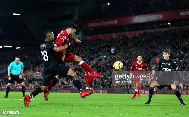 Alex OxladeChamberlain of Liverpool scores his sides fifth goal during the Premier League match between Liverpool and Swansea City at Anfield on...
