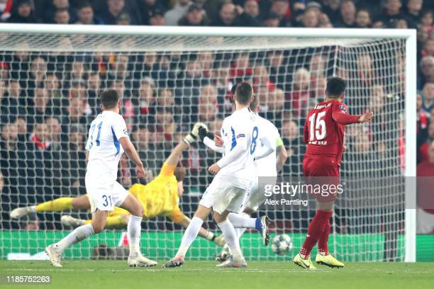 Alex OxladeChamberlain of Liverpool scores his sides second goal during the UEFA Champions League group E match between Liverpool FC and KRC Genk at...