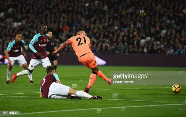 Alex OxladeChamberlain of Liverpool scores his sides third goal during the Premier League match between West Ham United and Liverpool at London...