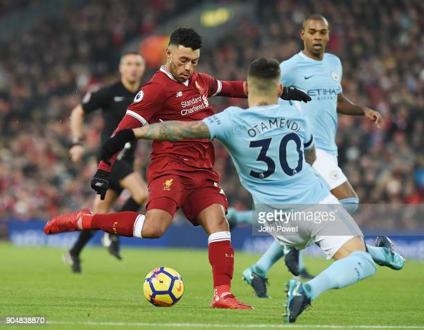 Alex OxladeChamberlain of Liverpool Scores the opener during the Premier League match between Liverpool and Manchester City at Anfield on January 14...