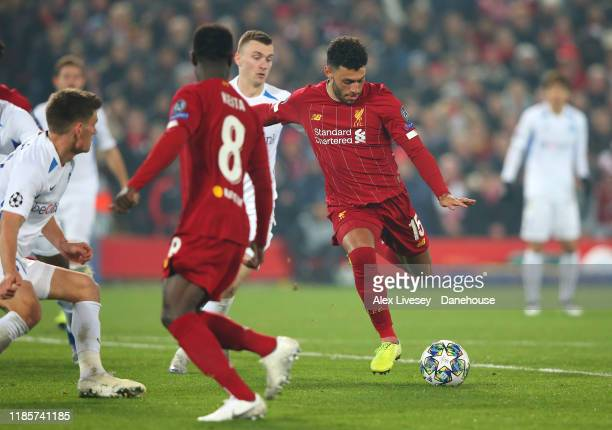 Alex OxladeChamberlain of Liverpool scores their second goal during the UEFA Champions League group E match between Liverpool FC and KRC Genk at...
