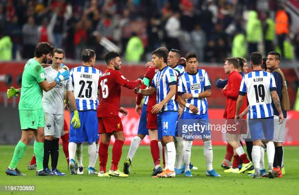 Alex Oxlade-Chamberlain of Liverpool shakes hands with Angel Zaldivar of C.F. Monterrey after the FIFA Club World Cup semi-final match between...