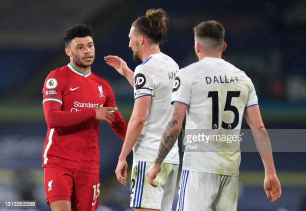 Alex Oxlade-Chamberlain of Liverpool shakes hands with Luke Ayling of Leeds United after the Premier League match between Leeds United and Liverpool...