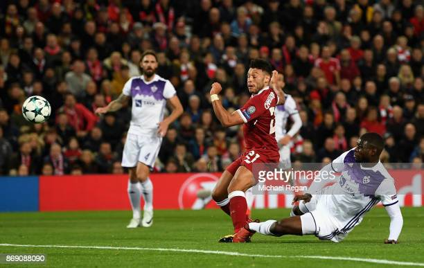 Alex OxladeChamberlain of Liverpool shoots during the UEFA Champions League group E match between Liverpool FC and NK Maribor at Anfield on November...