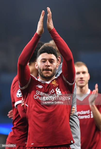 Alex OxladeChamberlain of Liverpool shows appreciation to the fans after the UEFA Champions League Quarter Final Second Leg match between Manchester...